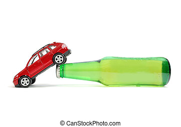 Drink driving - Toy car on a beer bottle
