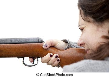 Shooting with air gun - Woman shooting with air gun -...