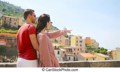 Young family with great view at old village Riomaggiore,...
