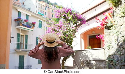 Back view of happy girl having fun during holidays in Cinque...