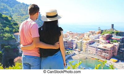 Young couple background of Vernazza, Cinque Terre national...