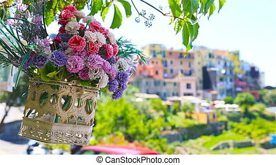 One of old five famous colorful villages of Cinque Terre National Park in Italy. Closeup on the beautiful flowers