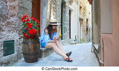 Happy woman in european vacation in Cinque Terre. Young...