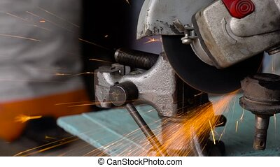 Angular grinding machine is cutting the metal and a lot of...