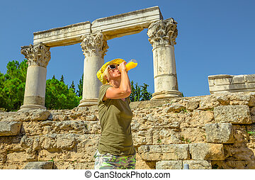 Ancient Corinth travel woman - Young happy tourist drinks...
