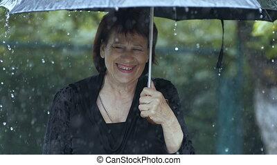 Woman crying under umbrella at rain - Woman crying under...