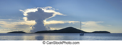 Resurrection in the clouds above Luis Pena Cay in Isla...