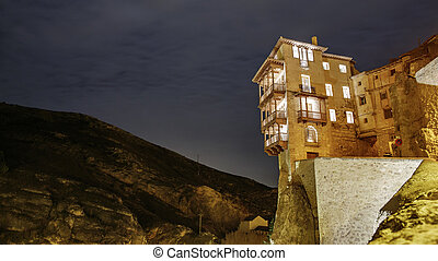 The famous hanging houses at night in Cuenca - Night view of...