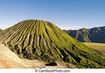 Green active volcano in the morning, Indonesia Bromo Park...