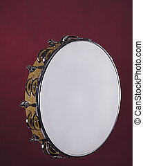 Tambourine Isolated on Red - A wood frame tambourine...
