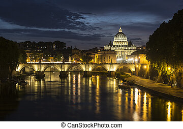 St. Peter's Basilica and Ponte Sant angelo at dusk in vatican city, Rome, Italy