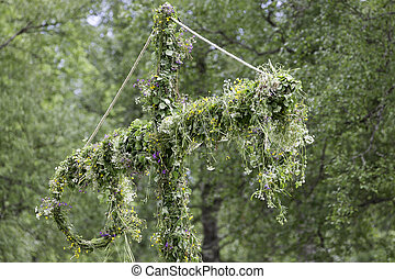 Swedish Maypole Covered in Flowers.