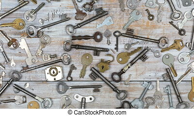 Time lapse of old keys on wooden background - Time lapse of...