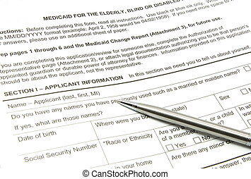 Medicaid Application and Silver Pen - A Medicaid application...