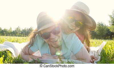 Young couple lying down in grass and having fun - Young...