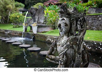 Stone sculpture on entrance door of the Temple in Bali Tirta...