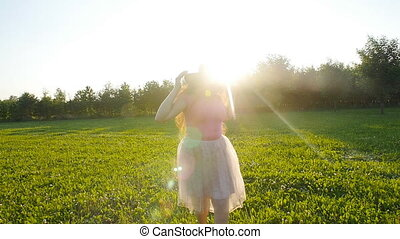 Happy young woman running on meadow on a sunny autumn day