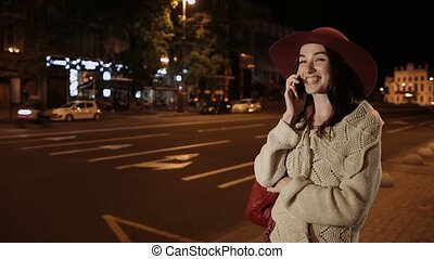 Happy girl talking on mobile phone in night city - Carefree...