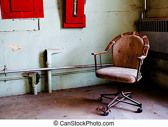 Office chair in prison room - Old office chair inside prison...