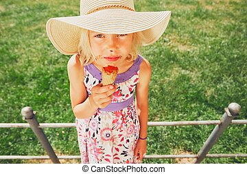 Girl with ice cream. - Summer day in the city. Cute little...