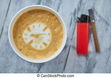 Coffee, lighter and cigarette.