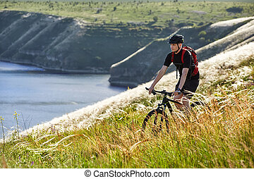 Attractive cyclist riding the bicyclist on the beautiful...