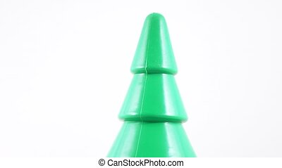 Plastic toy herringbone - Rotation of a green plastic...