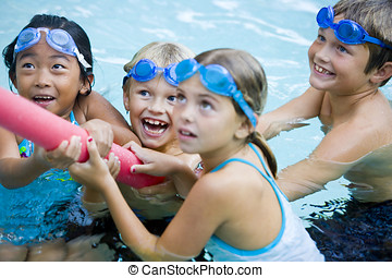 Children playing together with pool toy - Four kids 7 to 9...