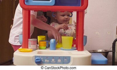 Two sisters playing in toy kitchen 4K