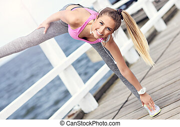 Woman stretching before jogging - Picture of woman...