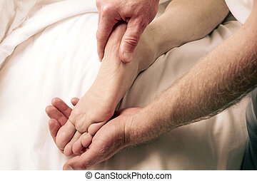 Man Massaging Male Foot - One mature guy receiving and one...