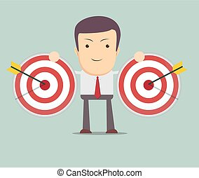 successful businessman aiming target with arrow
