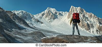 A man climbing up the mountain