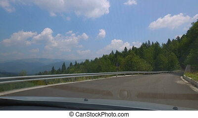 Car ride on the road in the mountains in summer - Car ride...