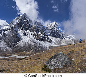 Photographer taking pictures on Everest base camp trek in...