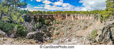 Wide angle of deep wolf torca in Cuenca - Panorama of round...