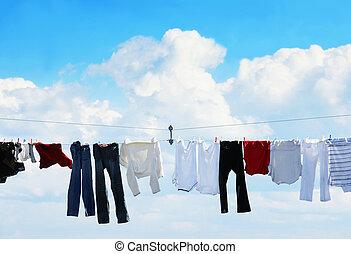 Clothesline and blue sky - Pants and shirts on clothesline...