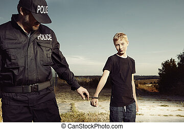 Teenage pickpocket catched by police officer in field -...