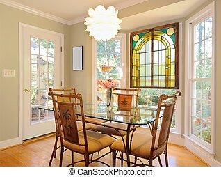 Breakfast Table in a bay window niche in a home.