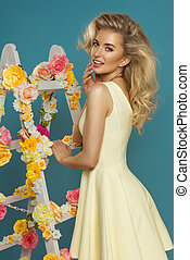 Delicate blonde pastel woman with flower white ladder