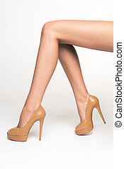 Photo of sexy, shapely, seductive female legs in the studio