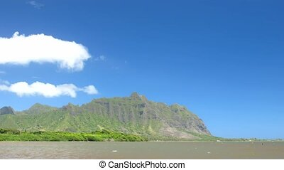 Kualoa - Time lapse clouds over Kualoa Mtn Range, Ohau,...