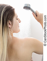 Woman with long blond hair taking shower