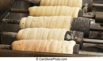 The Czech national dish Trdelnik is cooked and roasted - The...