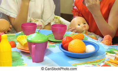 Child playing with plastic tableware