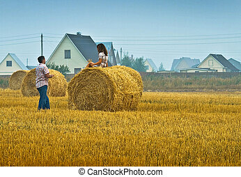 rural life - couple in an agricultural field