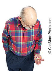 senior citizen with drugs - senior man holding a handful of...