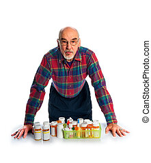 senior with prescription bottles - A senior citizen reviews...
