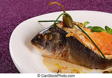 Fish sea bass stuffed with mushrooms sauce