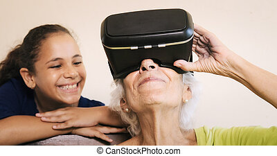 Virtual Reality Happy Grandmother And Young Girl Playing Together